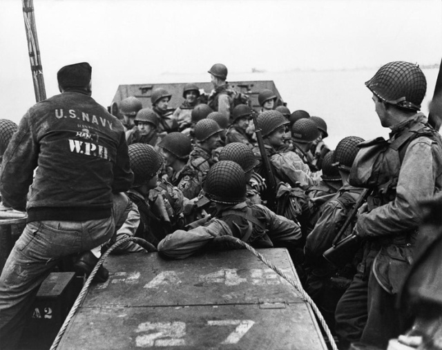 "GIs of the 1st Infantry Division ""Big Red One,"" leave port at Weymouth, England, for the invasion of Normandy on June 6th, 1944.  Photo by Robert Capa"