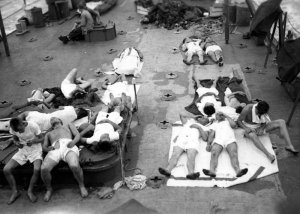 Survivors from the USS Indianapolis (CA-35), onboard the USS Bassett (APD-73) after being rescued.
